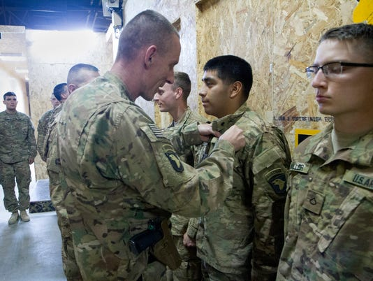 Task Force Strike Soldiers receive Combat Action Badges