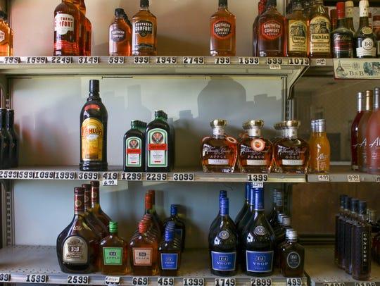 Various types of liquor sit on the shelves of University