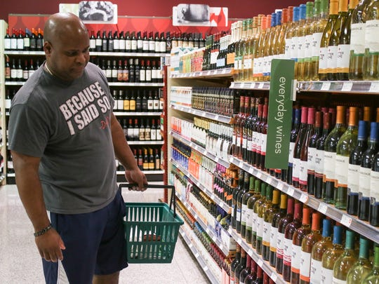 Todd Franks looks at the wine selection at Publix on