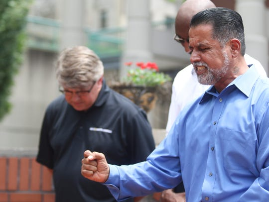 County Commissioner and Pastor Tommy Vallejos prays