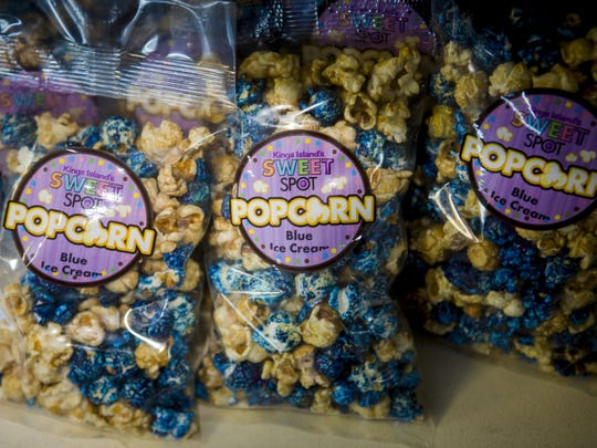 Kings Island now sells blue ice cream popcorn inspired by their iconic blueberry-based soft serve.
