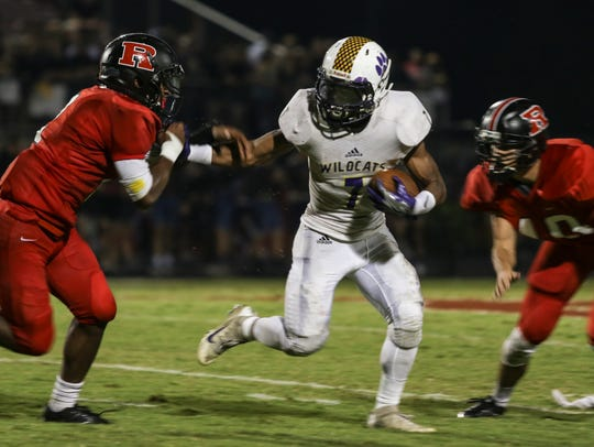 Clarksville's Malik Santiago (7) tries to run in between