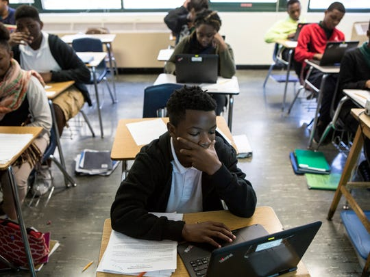 November 1, 2016 - Tevion Hedrick, 13, studies an online ballot while voting in a statewide mock election during Ben Hyde's eighth grade history class at Sherwood Middle School.