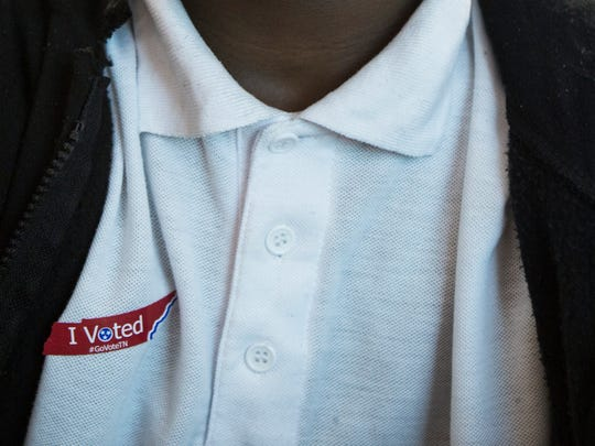 November 1, 2016 - Tevion Hedrick, 13, wears his I Voted sticker after casting an online ballot in a statewide mock election during Ben Hyde's eighth grade history class at Sherwood Middle School.