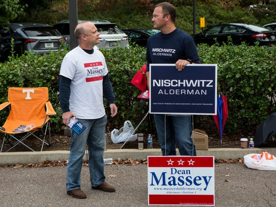 November 8, 2016 - Dean Massey (left) and David Nischwitz, who are both  running for Germantown alderman positions, talk while campaigning outside a voting location at Riveroaks Reformed Presbyterian Church.