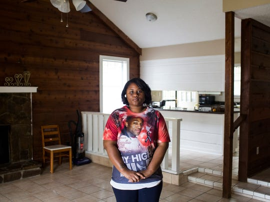 November 2, 2016 - Shakerria Minor-Byers stands in her new home after moving from where she and her family lived when her husband of seven years was shot and killed during a home invasion in July.