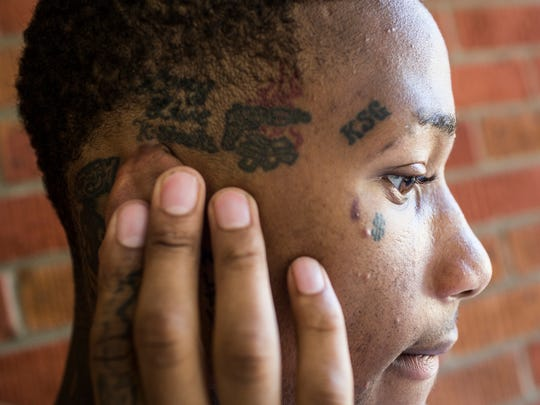 November 1, 2016 - J.T. Neil shows off one of the many tattoos he got in honor of his 17-year-old brother, Kerr-Dulea Neil, who was shot and killed behind Frayser Elementary School in April of 2016. Neil also has the date that his brother was born and died tattooed above his left eyebrow as well as a tattoo on his arm in honor of his brother.