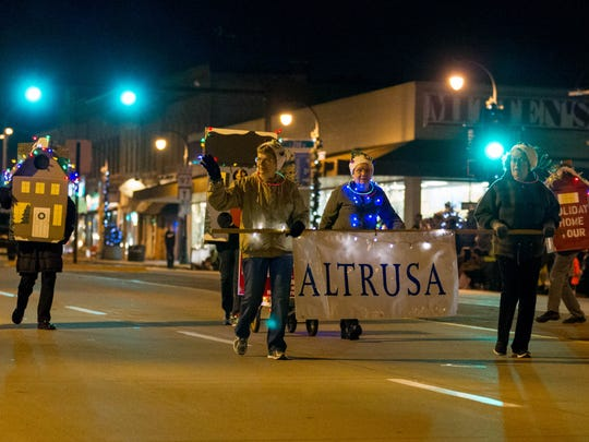 ALTRUSA joins the Marshfield community as it gathers between South Central Avenue and 14th Street to watch the annual Marshfield Holiday Parade on Thursday November 17, 2016, in Marshfield, Wisconsin. 