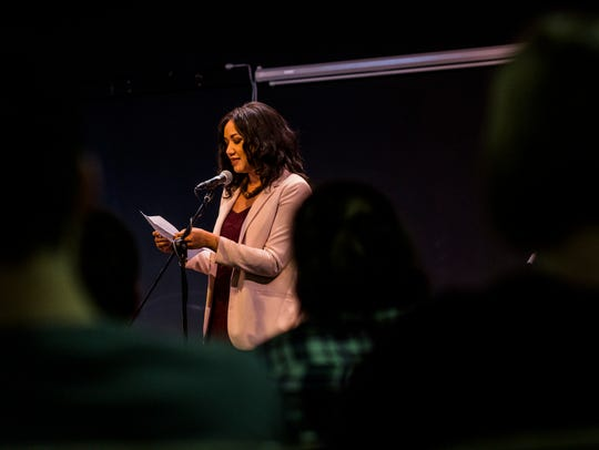 Tiana Clark MC's an open mic night after leading a