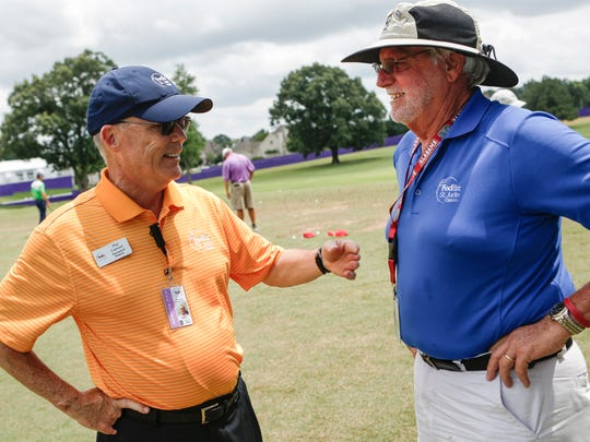 June 4, 2014 - Tournament director Phil Cannon, left, talks with Ira Ellsworth on the practice range during the Wednesday Window World Pro-Am at the FedEx St. Jude Classic at TPC Southwind. Cannon has been the tournament director since 2000.