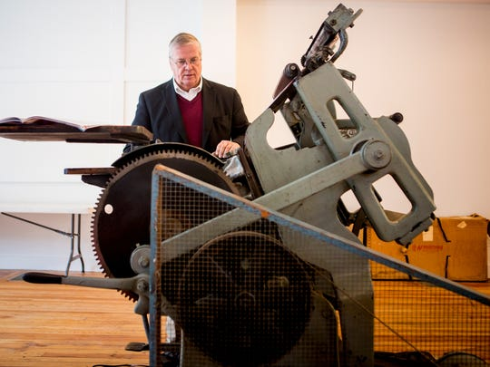 Gary Walton, Professor Emeritus at Cincinnati State Technical and Community College, examines a letterpress inside the new Cincinnati Letter & Type Museum and BLOC Letterpress on 8th street in Lower Price Hill Thursday, December 22, 2016.