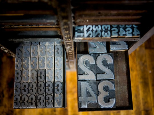 Letterpress numbers of a variety of size and font fill this cabinet in the back of the new Cincinnati Letter & Type Museum and BLOC Letterpress on 8th street in Lower Price Hill Thursday, December 22, 2016.