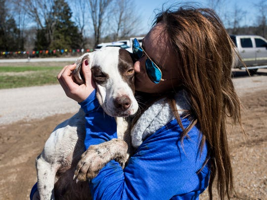 February 15, 2017 - Part owner Rachel Blackwell embraces Coldwater Thunder, also known as Lulu, after the pointer was the first to finish the course during the 118th National Championship for Bird Dogs at Ames Plantation.