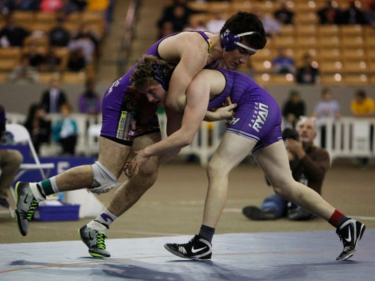 George Hooker of Father Ryan (right) wrestles Grayson Walthall of Christian Brothers in the Division II 220 weight class of the TSSAA State Wrestling championships in Franklin.