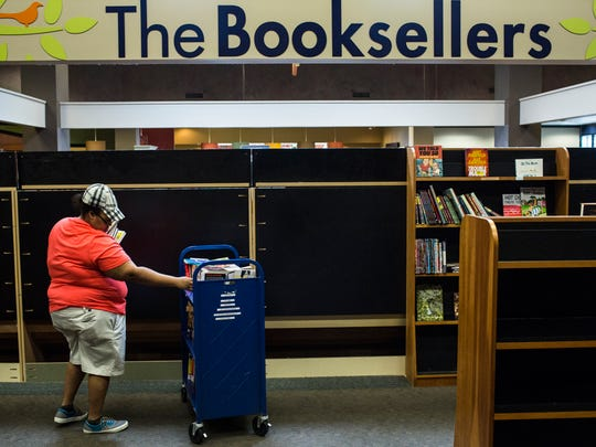 """February 20, 2017 - Stephanie Bell looks at a rack of books while going through the Booksellers at Laurelwood one last time before the store closes its doors for good. """"I finally found a great bookstore but then found out that they were closing,"""" said Bell, who recently moved to Memphis. """"It's so sad, the staff here are so amazing."""" Booksellers is the largest independent bookstore in Memphis."""