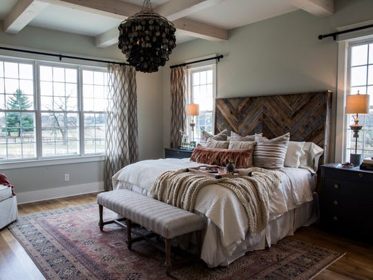 The master bedroom at the The House For Hope in Franklin is adjacent to the downstairs living room.