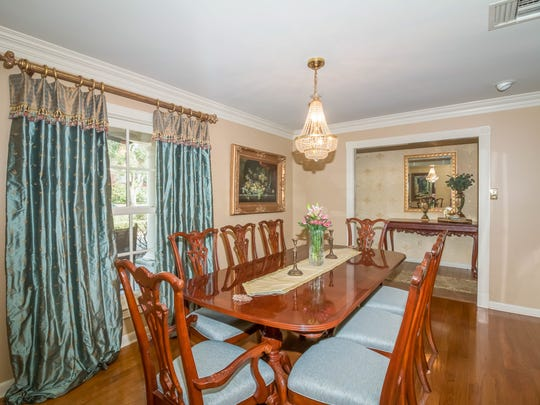The formal dining room is large enough for any gathering.