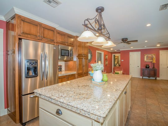 The kitchen includes granite counter tops and plenty of storage space.