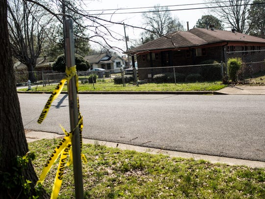 March 21, 2017 - Crime scene tape is seen near a home