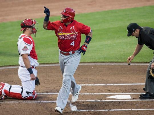 March 30, 2017 - Yadier Molina celebrates after hitting