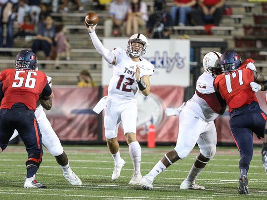Brandon Silvers throws for some of his career-high 395 yards in Troy's October win at South Alabama in Ladd-Peebles Stadium in Mobile, Ala. on Thursday, October 20, 2016.