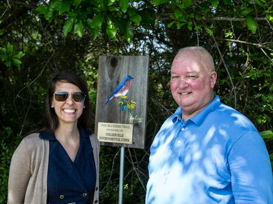 April 20, 2017 - Crystal Warren, left, chair of the Collierville Environmental Commission, and Fred Robertson, right, president of the Shelby County Chapter of the Tennessee Bluebird Society, pose for a portrait near a sign commemorating a new bluebird birdhouse along the bluebird trail at W.C. Johnson Park in Collierville. The Collierville Environmental Commission sponsored the new birdhouse which is the third in Collierville.