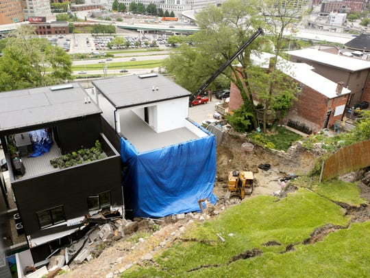A retaining wall collapsed early Wednesday morning causing a landslide to damage two Mount Adams homes on Baum Street.