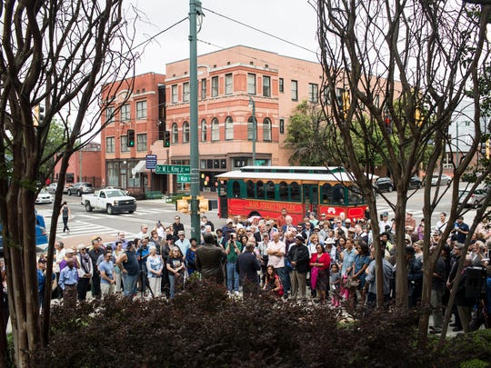 """May 12, 2017 - A crowd gathers to watch the dedication of a bronze statue of Bobby """"Blue"""" Bland installed on the MLGW property at the corner of South Main and Dr. Martin Luther King, Jr. Avenue."""