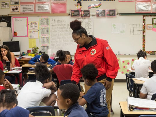 May 18, 2017 - Brittany Brown works with students in a City Year Tier 1 class at Brownsville Elementary school. City Year, an Americorps program that supports schools in poor areas, is wrapping up its first year in Memphis. The program employs recent college graduates to work in support roles in schools, focusing on issues like attendance and behavior.