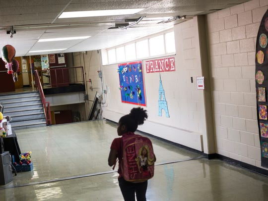 May 18, 2017 - A student makes her way to class at