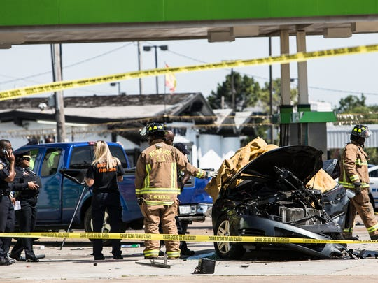 "May 26, 2017 - Memphis police and fire personnel work the scene of a crash where one person was killed and several injured at the intersection of Winchester and Airways. ""This was a multiple vehicle crash that involved a MFD vehicle,"" said Memphis police spokesman Louis Brownlee. ""The MFD employee was transported non critical."