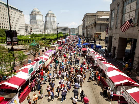 Thousands attend the 39th annual Taste of Cincinnati on Fifth Street Saturday, May 27, 2017.
