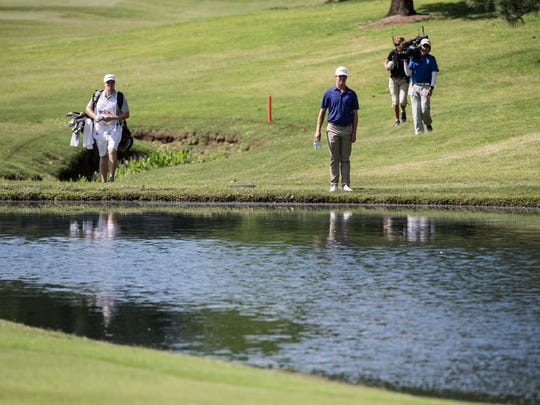 Cody Gribble looks out across the water after having hit his ball into the water hazard on the 18th hole at the FedEx St. Jude Classic at TPC Southwind in 2017.