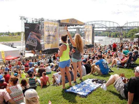 Fans enjoy one of the free Riverfront Park performances during the CMA Festival. Joe Buglewicz / The Tennessean