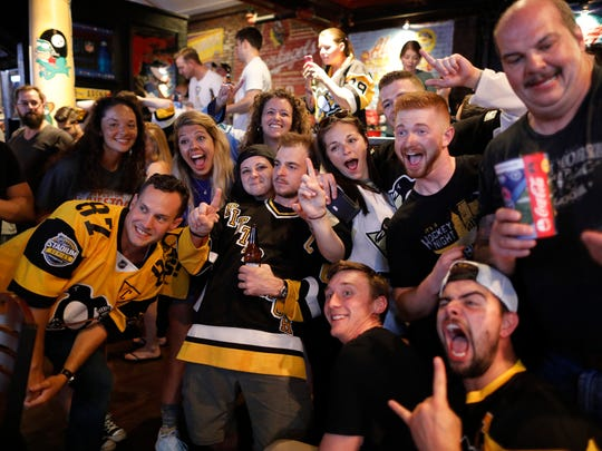 Penguins fans celebrate their Stanley Cup victory at