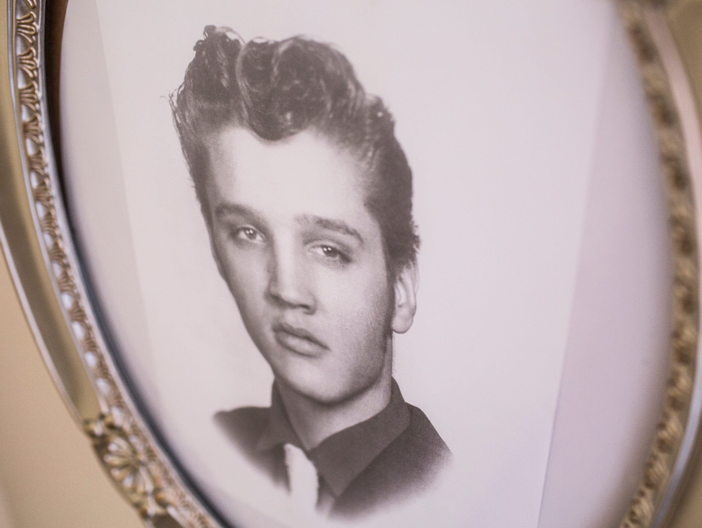 A framed picture of Elvis Presley is seen within the apartment he called home for 4 years in the Lauderdale Courts apartment complex. Elvis, Gladys and Vernon Presley lived in the apartment from September 1949 to January 1953.