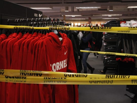 Caution tape is placed around Cornell merchandise made