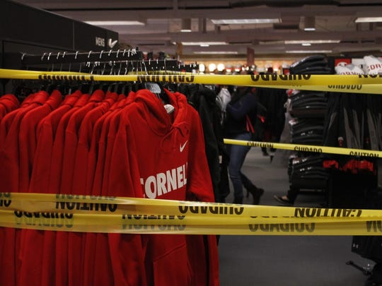 Caution tape is placed around Cornell merchandise made by Nike during a protest by the Cornell Organization for Labor Action in May.