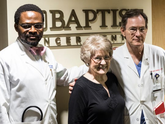 July 12, 2017 - Dr. Raymond Osarogiagbon, left, and Dr.Todd Robbins, right, co-directors of the multidisciplinary thoracic oncology program with the Baptist Medical Group, pose for a picture with Marthanne Maroney. Maroney's lung cancer was found and treated at an early stage thanks to a new process at Baptist Memorial Healthcare.