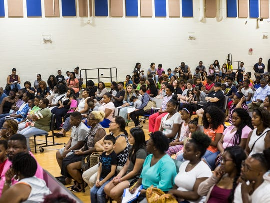 People filled the gymnasium during a orientation for parents at one of Willie Herenton's charter schools in July 2017.