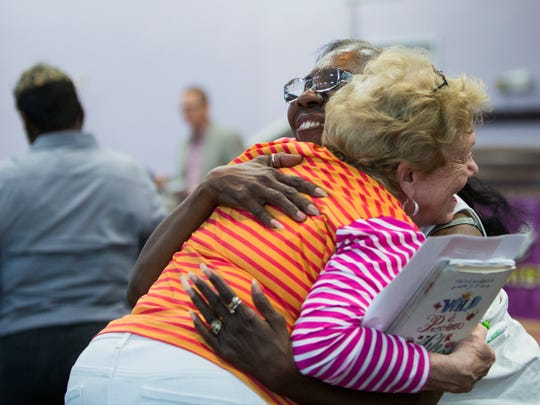 August 8, 2017 - Dorothy Porter, right, hugs Linda Marks, left, after a short one on one session during a meeting for Memphis Interfaith Coalition for Action and Hope at Olivet Fellowship Baptist Church. MICAH is a multi-racial, interdenominational, nonprofit group comprised of local congregations, community organizations, and labor unions.