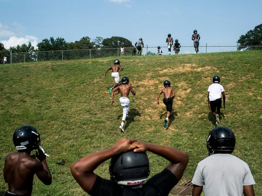 August 8, 2017 - Mitchell High School football players run a hill for endurance before the start of practice.