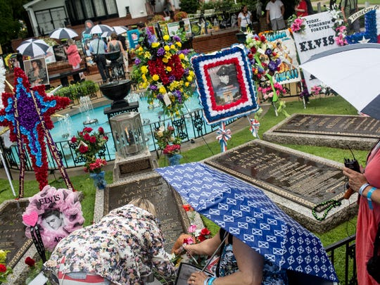 August 11, 2017 - Elvis Presley fans leave flowers at his gravesite at Graceland. ElvisÊwas baptized as a child by a Trinitarian Pentecostal preacher in Tupelo, as a young teenager by a Oneness Pentecostal preacher in Memphis and baptized, posthumously, by members of the Church of Jesus Christ of Latter-day Saints.