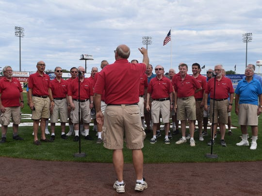"""Led by Don Reckenbeil, the award-winning Hunterdon Harmonizers recently performed at the champion Somerset Patriots baseball game. Some of the music included John Denver's """"CountryRoads,""""and other barbershop favorites: """"Top of the World,"""" """"Coney Island Baby"""" and the patriotic """"God Bless America."""" The Harmonizers were joined by Barbershop performances from the Morris Music Men and Jersey Harmony Express singingthe national anthem. Coincident to the a cappella performances by the three choruses, the Amazing Spiderman entertained the crowd after being serenaded by the Harmonizers with hisSpider Man music classic."""