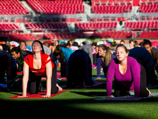 More than 500 people participate in an hour-long yoga