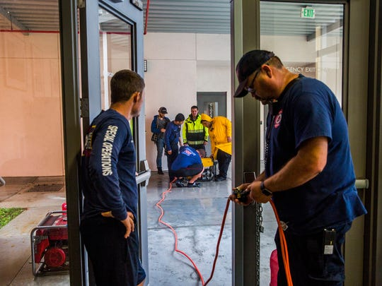 Immokalee Fire and Rescue crews power up a generator after power went out as Hurricane Irma moves closer in Immokalee on Sunday Sept. 10, 2017.