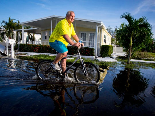 Resident Charles Pulkownik, 56, rides in Naples Estates trailer park in East Naples Monday, Sept. 11, 2017, after Hurricane Irma passed through Southwest Florida.