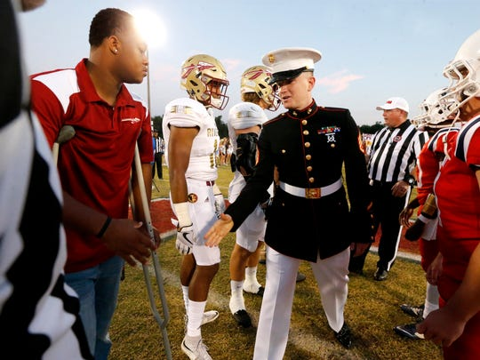 Marine Staff Sgt. Brian Raney shakes the hand of Riverdale's