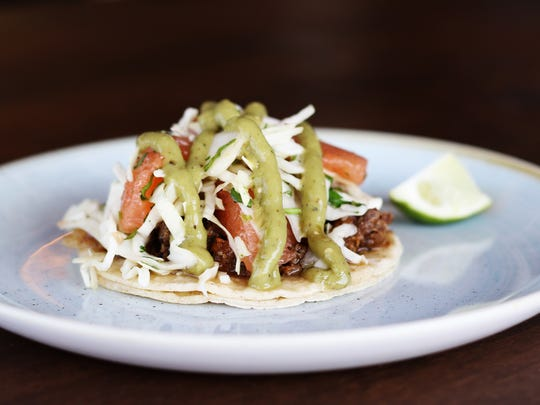 The cachete de res tacos at Tacos Tequila Whiskey.