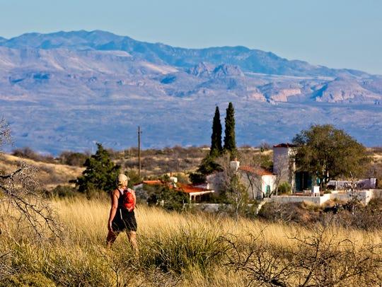 A hiker enjoys views of the Kannally Ranch House in